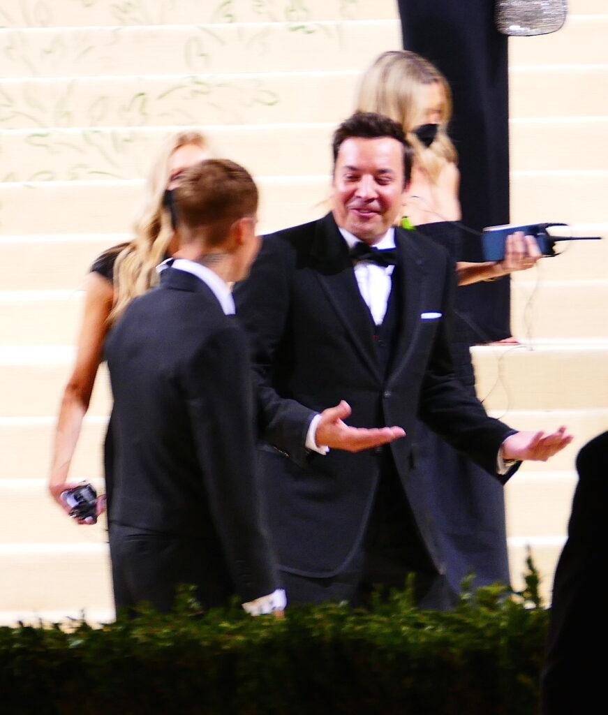 Justin Bieber has a moment with Jimmy Fallon as the comedian laughs as Justin apos s female handlers help fix his wardrobe at Met Gala in NYC