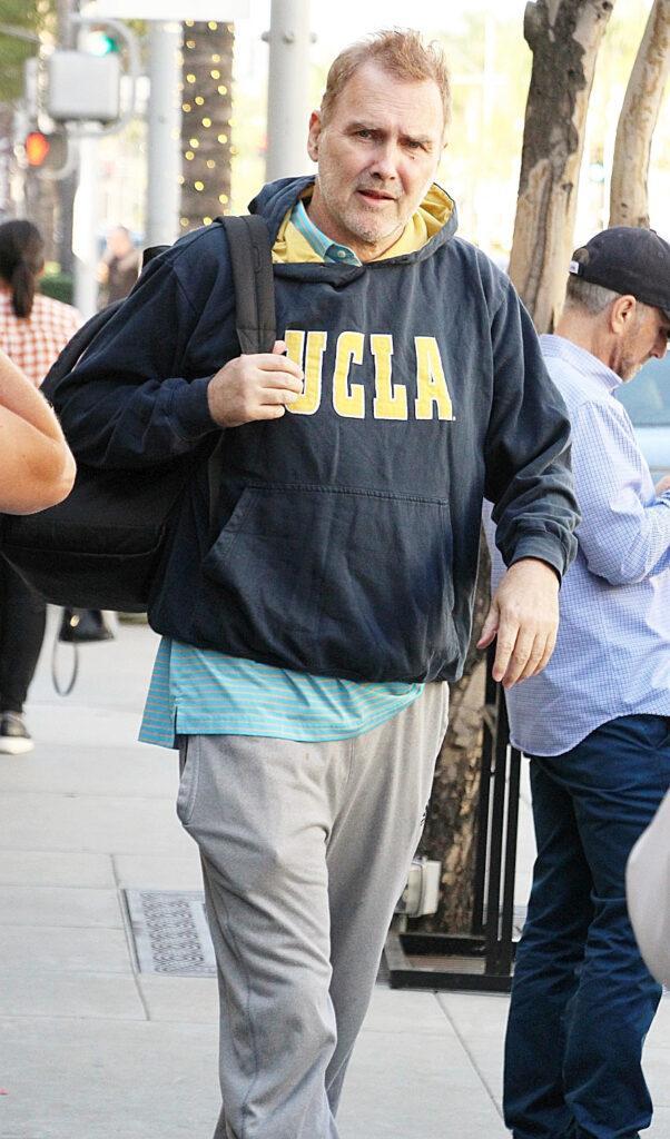 Canadian comedian Norm MacDonald seen wearing UCLA sweat shirt