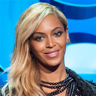 Beyoncé Flaunts Diamonds & Cleavage In A Sexy Silk Dress In Venice