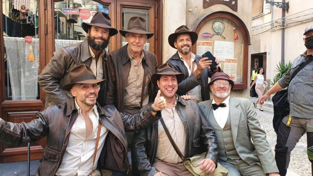 """Harrison Ford poses with members Italy's Indiana Jones Fan Club all dressed in full """"Indy"""" costume while filming """"Indiana Jones 5"""" on location in Italy."""