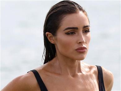 Olivia Culpo Flaunts New 'Weapon Of Choice' In Stunning Bond Girl Outfit