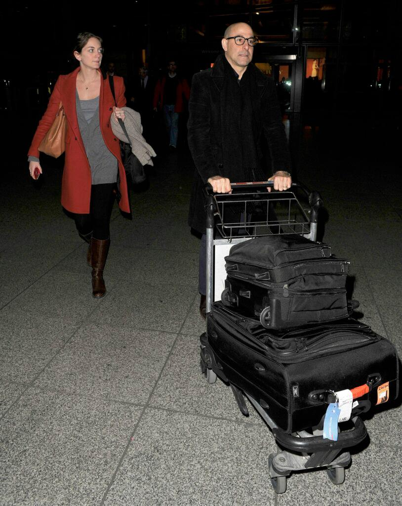 Stanley Tucci and his wife Felicity Blunt arriving into Heathrow Airport