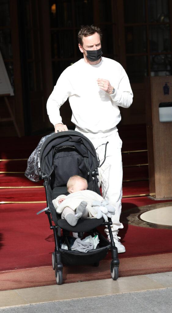 Michael Fassbender and his newborn in Paris during Fashion Week
