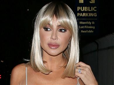 Larsa Pippen Stuns In Plunging Silk Dress & Blonde Wig At Drake's Halloween Party In Hollywood